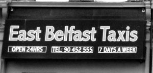 Fig. 24 This taxi sign references place and uses red, a colour expressing Unionist community ties